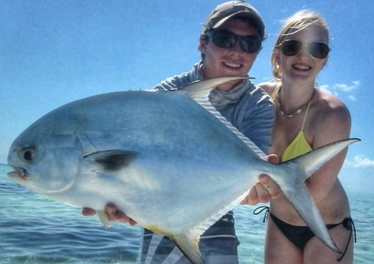 fly fishing for permit with a happy couple